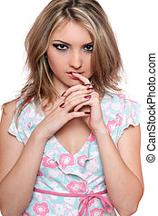Portrait of passionate young blonde. Isolated