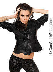 Portrait of passionate young brunette in black clothes. Isolated