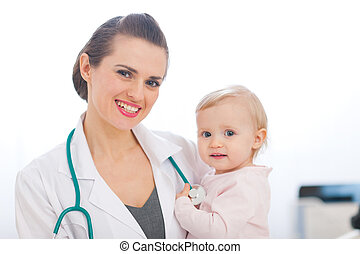 Portrait of pediatric doctor with kid
