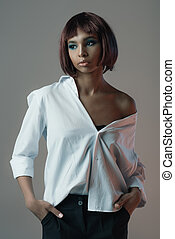 portrait of pensive african american woman in shirt looking away