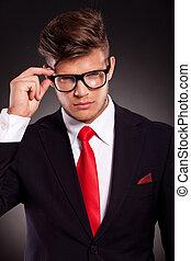 business man holding his eyeglasses