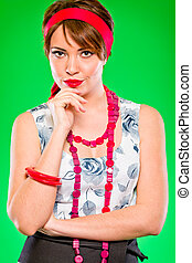 Portrait of pensive charming girl holding hand near head. Pin up and retro style