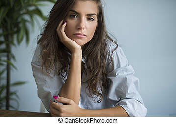 Portrait of pensive woman in the sitting room