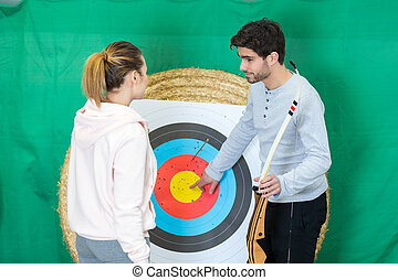 portrait of people during the archery lesson
