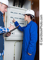 portrait of people reading the electrical panel questions