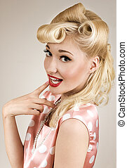 Portrait of pin-up blonde woman with finger on her lips