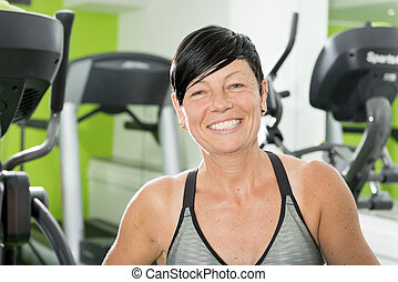 Portrait of Pixie-Haired Athletic Brunette in Gym