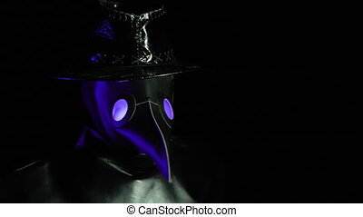 Portrait of plague doctor with crow-like mask isolated on black background. Creepy mask, halloween, historical terrible costume concept. Epidemic.