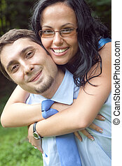 Portrait of playful cute young couple hugging