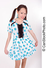 playful girl in a spotted dress