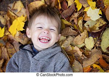 Portrait of playful little boy in the park