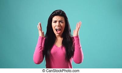 Portrait of pleasant brunette girl throwing up her hands....