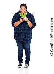 plus size beautiful woman eating lettuce
