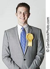 Portrait Of Politician Wearing Yellow Rosette