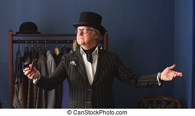 Portrait of posh mature gentleman visiting a tailor's shop -...