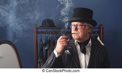 Portrait of posh mature gentleman visiting a tailor's shop....