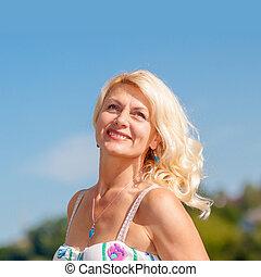 Portrait of positive elderly blonde woman. Mature beautiful...