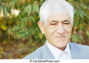 Portrait of positive senior man