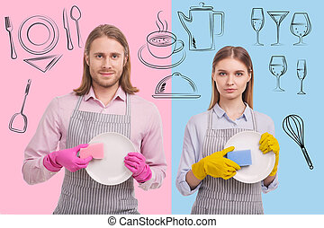 Portrait of positive waiters washing dishes