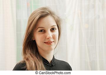 Portrait of positive woman in black