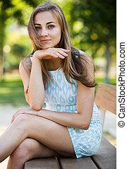portrait of positive young female portrait in garden