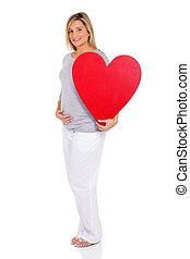 pregnant woman holding red heart