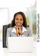 african american businesswoman relaxing in office