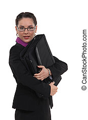 portrait of pretty bespectacled businesswoman holding briefcase