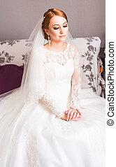 Portrait of pretty bride in the room