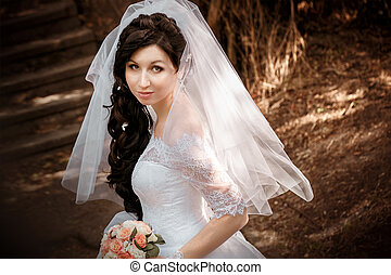 Portrait of pretty bride with veil
