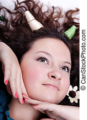 portrait of pretty brunette with horns