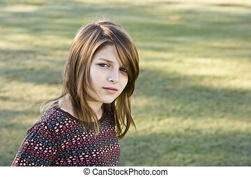 Portrait of pretty child with serious expression