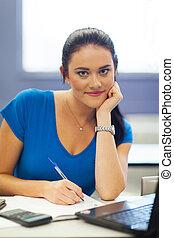 pretty college student in lecture room - portrait of pretty...