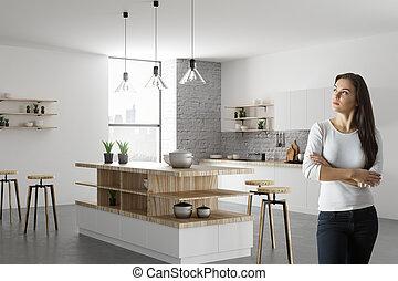 Portrait of pretty female in kitchen
