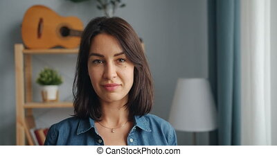 Portrait of pretty girl in casual clothing smiling looking ...