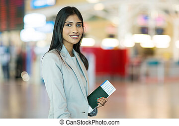 indian female business traveller at airport