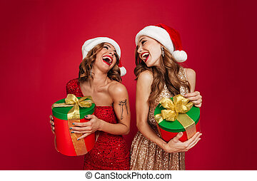 Portrait of pretty laughing women in christmas hats