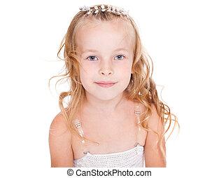 Portrait of pretty little girl in beautiful white dress...