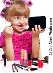 Portrait of pretty little girl with makeup