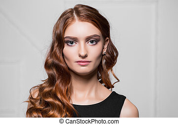 Portrait of pretty red-haired woman