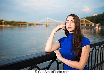 Portrait of pretty thoughtful young brunette