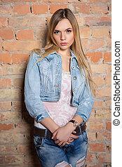 Portrait of pretty woman posing standing