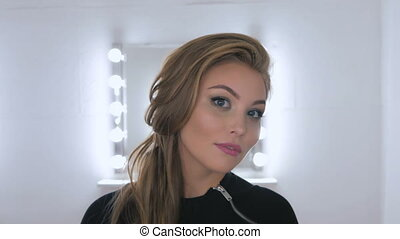 Portrait of pretty woman with beautiful make-up and elegant hairstyle