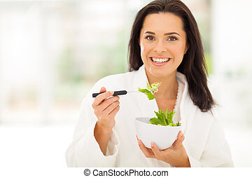 pretty woman with green salad