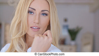 Portrait of Pretty Woman with long Blond Hair
