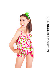Portrait of pretty young brunette woman in colorful pajamas