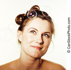 portrait of pretty young brunette woman on white background making bubbles happy smiling, lifestyle people concept