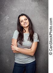 Portrait of pretty young brunette woman