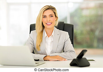 young business woman relaxing in office