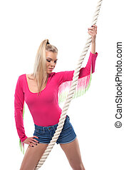 Portrait of pretty young fitness girl with rope